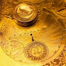 Old clock with zodiac elements and golden
