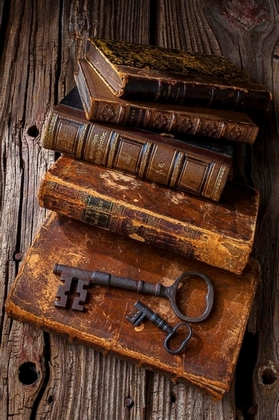 Antique books and key
