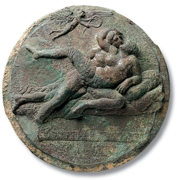 igure 2. Male-female couple with Eros, exterior of a mirror case, bronze, from Corinth. Museum of Fine Arts, Boston.