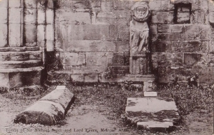 Sir Michael Scott the Wizard statue at his grave in Melrose Abbey—statue no longer there; boss of Sir Micha