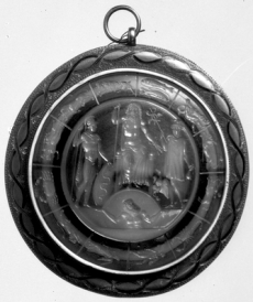This intaglio depicts Jupiter enthroned and flanked by Mercury on the right